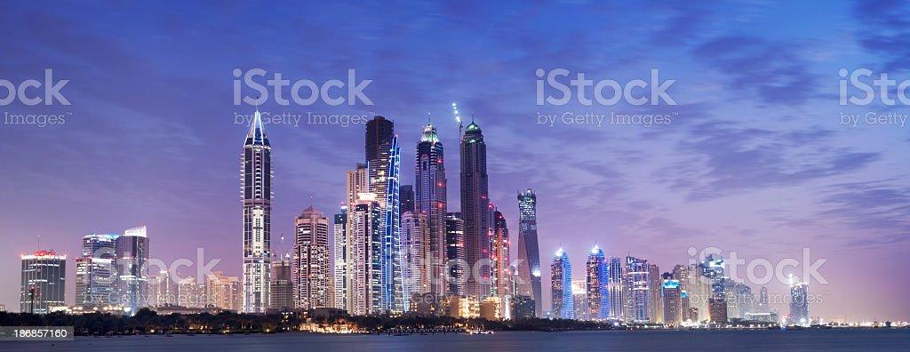Panoramic View of Illuminated Dubai Marina Skyline at Night UAE stock photo