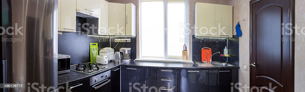 panoramic view of kitchen with appliances and utensils stock photo