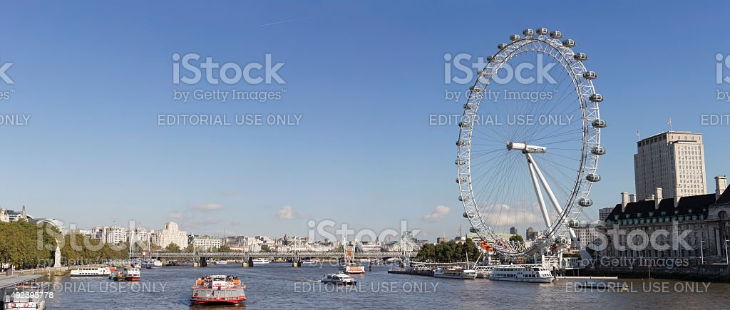 Panoramic view of London Eye and Hungerford Bridge stock photo