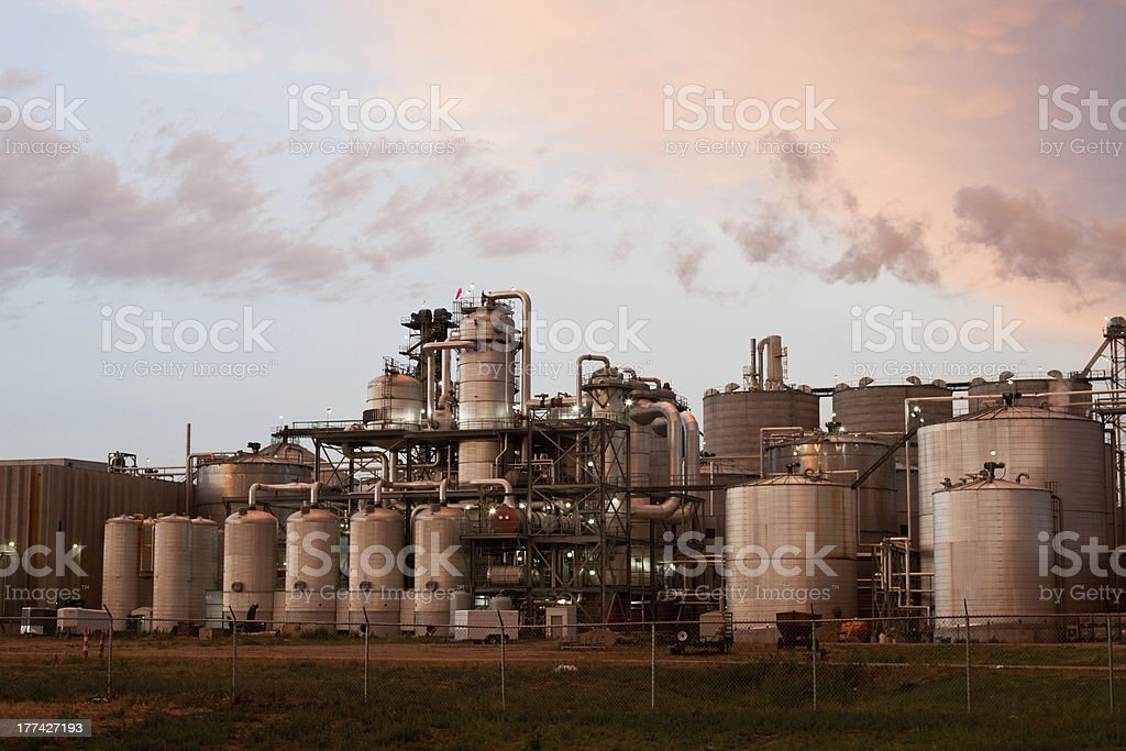 Panoramic view of massive refinery factory at sunset stock photo