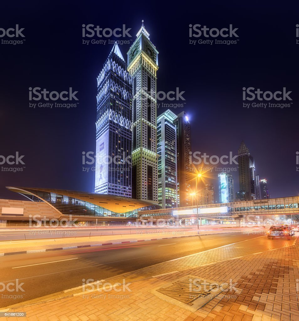 Panoramic view of metro station in Financial district at night, Dubai, UAE stock photo