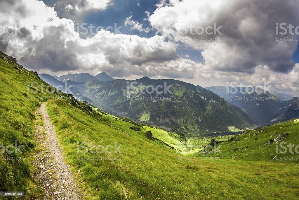 Panoramic view of mountain peaks from the trail in summer royalty-free stock photo