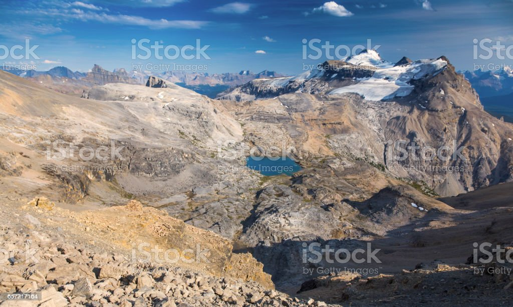 Panoramic View of Noseeum Lake and Glaciated Mount Andromache on east side of Icefields Parkway in Banff National Park stock photo