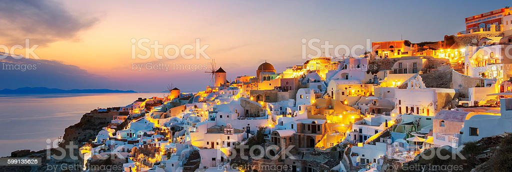 Panoramic view of Oia at sunset stock photo