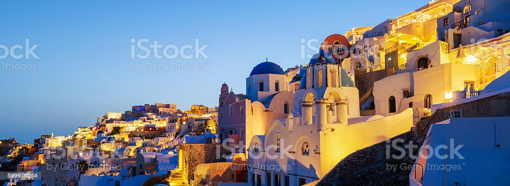 Panoramic view of Oia village at night stock photo