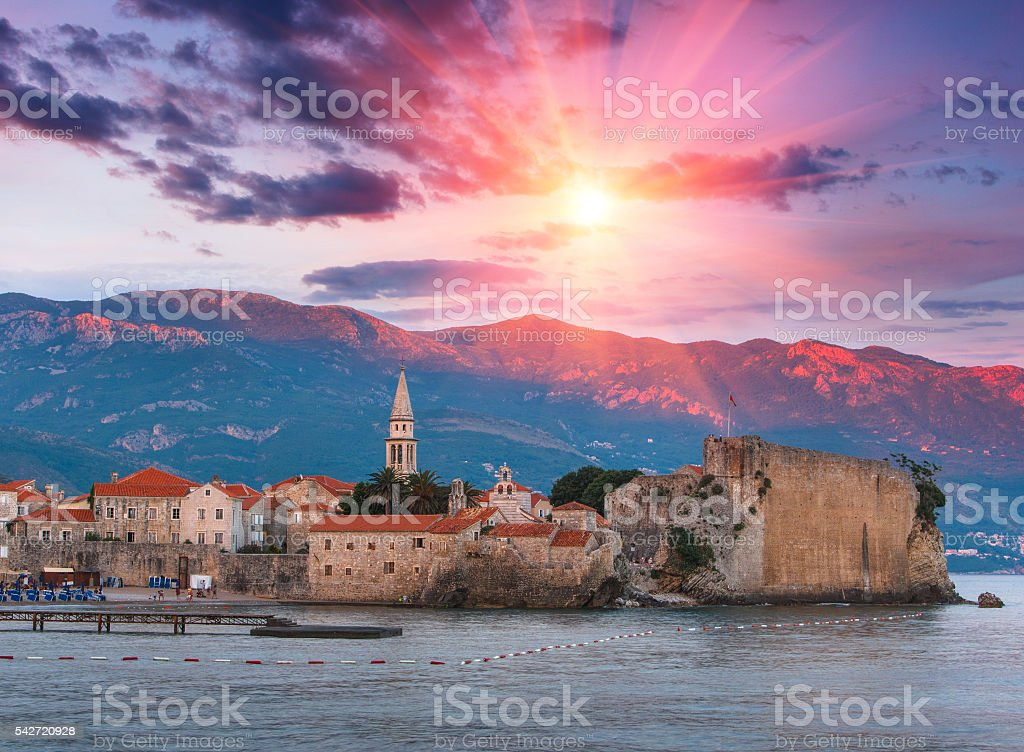 Panoramic view of old town Budva at sunset. Montenegro. stock photo