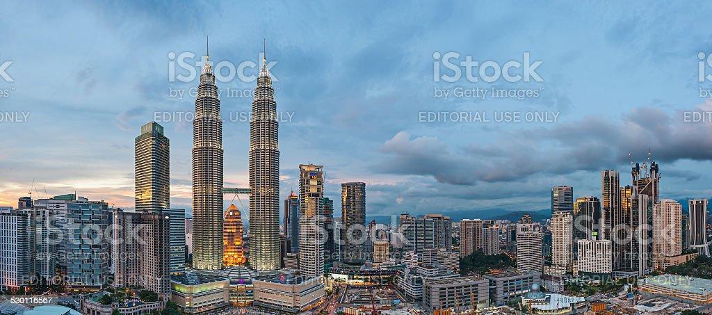 Panoramic View of Petronas Twin Towers, Kuala Lumpur before blue stock photo