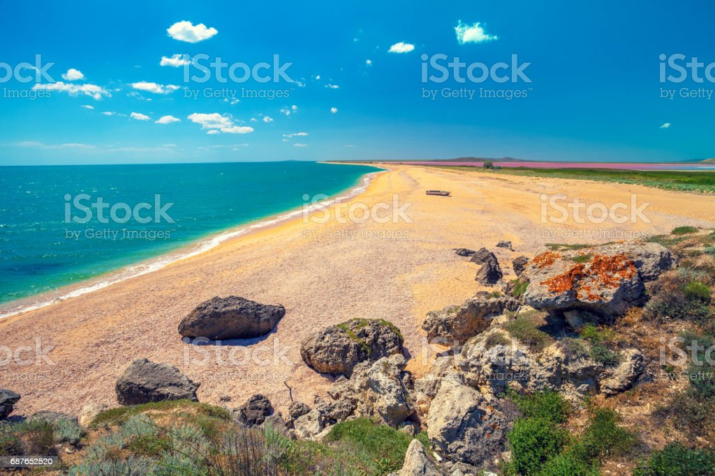 Panoramic view of Pink lake and the sea. Deserted beach stock photo