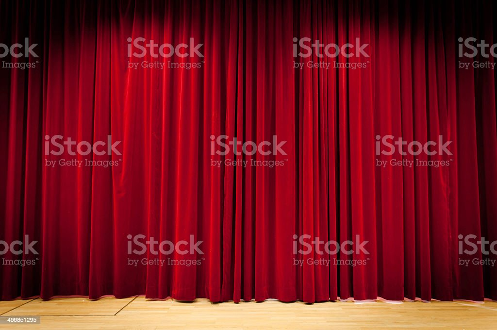 Panoramic view of red velvet curtain in theatre royalty-free stock photo
