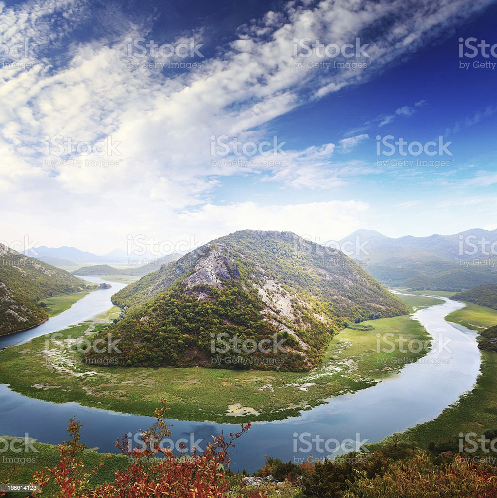 Panoramic view of river and mountains stock photo