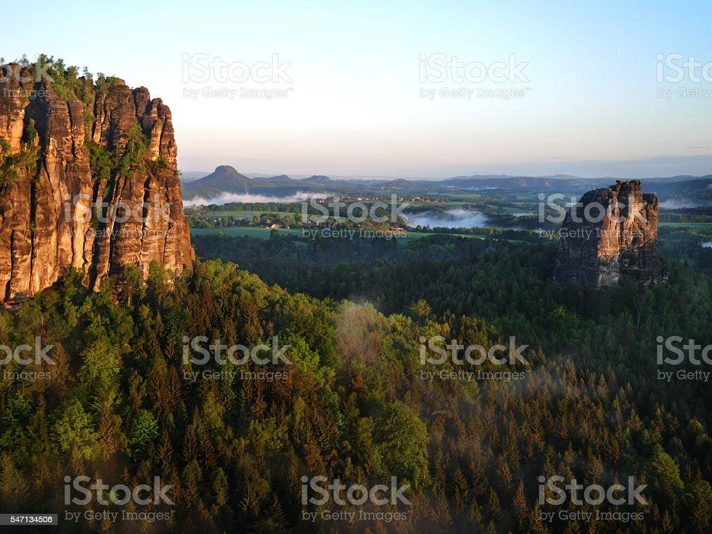 panoramic view of saxon Elbsandstein Mountains at dawn stock photo