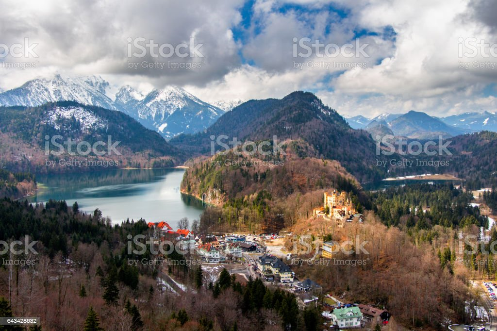 Panoramic view of scenic idyllic winter landscape in the Bavarian Alps at famous mountain lake Alpsee, Fussen, Allgau, Upper Bavaria, Germany stock photo