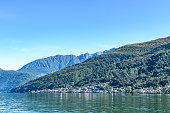Panoramic view of serene Lugano lake surrounded by hills, Morcote