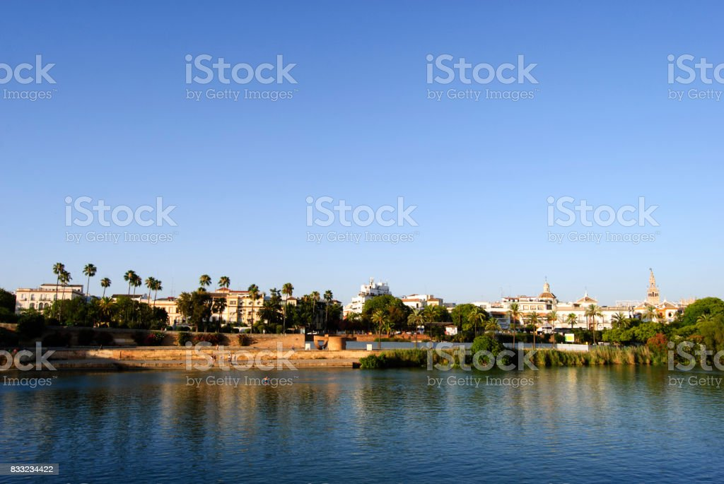 Panoramic view of Seville riverbank with La Giralda in the back stock photo