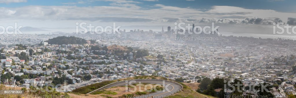 Panoramic View of Sharp Turn Road with San Francisco in the Background stock photo