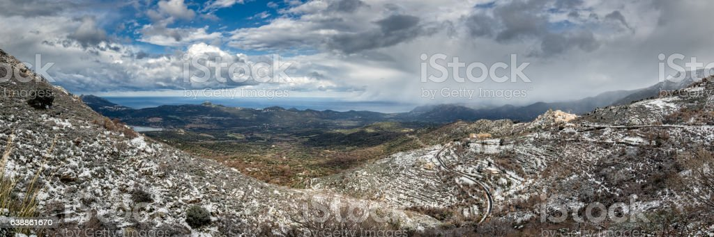 Panoramic view of snow on mountain village of Speloncato in Corsica stock photo