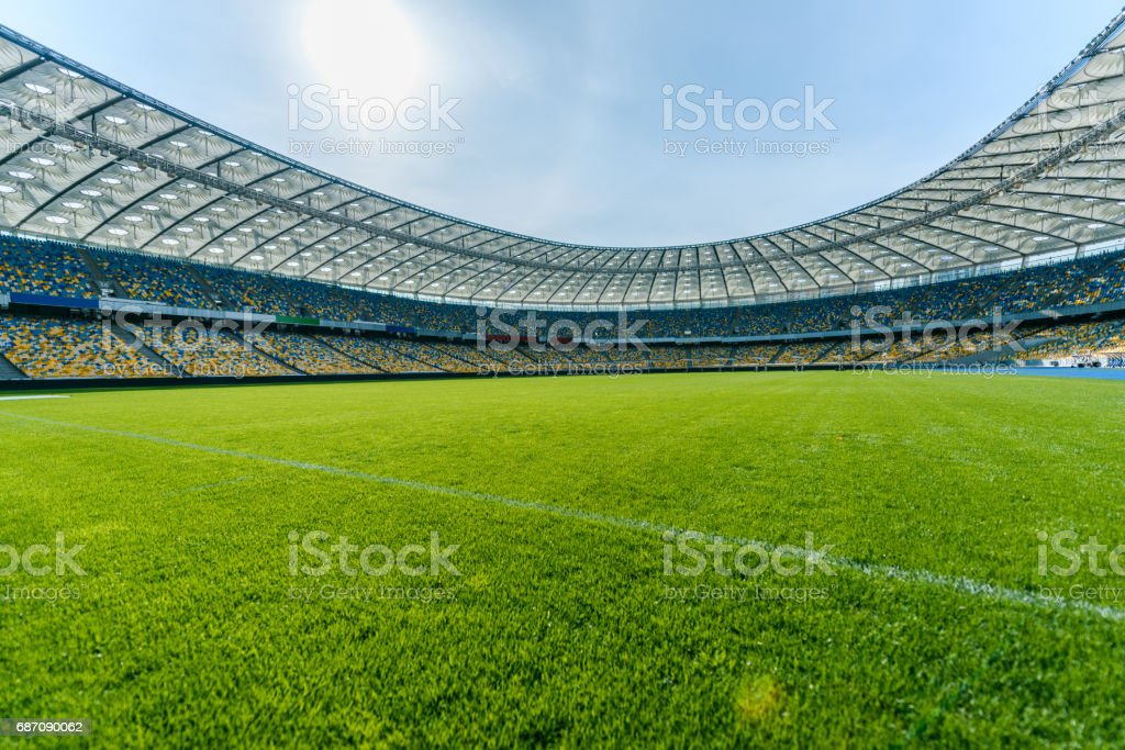 Panoramic view of soccer field stadium and stadium seats stock photo