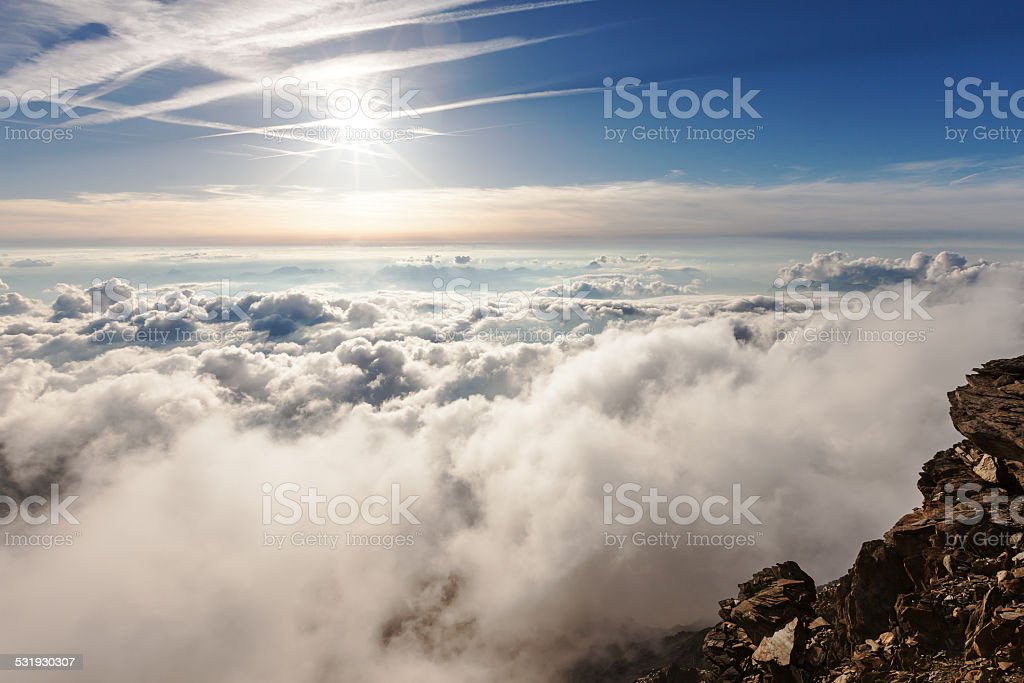 Panoramic view of the clouds over the Alps stock photo