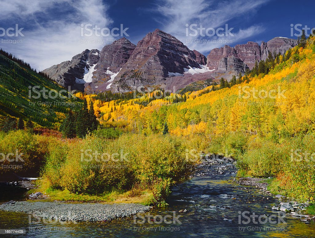 Panoramic view of the Maroon Bells Peak with Aspen trees stock photo