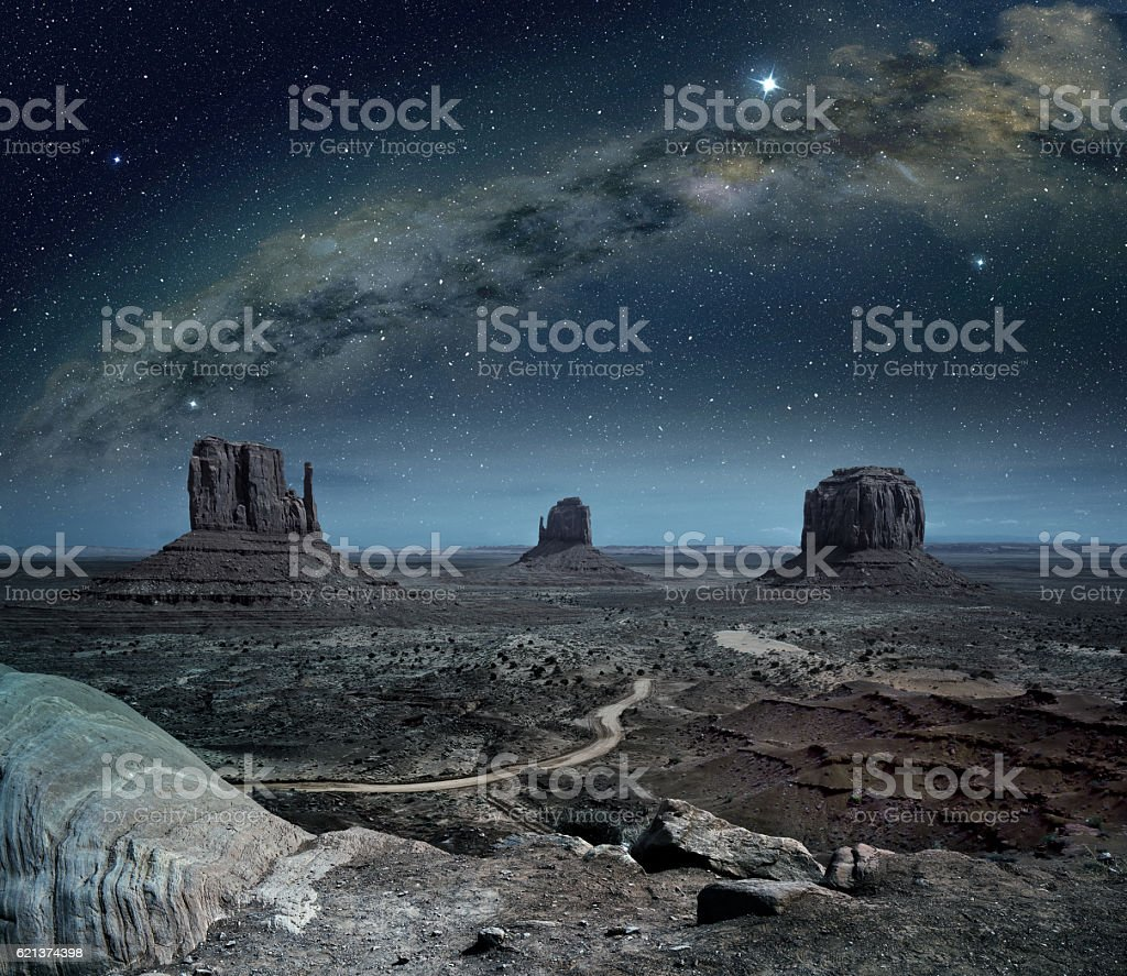 panoramic view of the milky way in monument valley stock photo