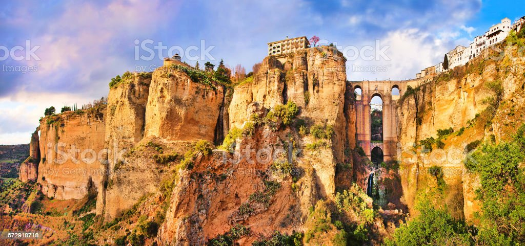 Panoramic view of the old city of Ronda, one of the famous white villages, at sunset in the province of Malaga, Andalusia, Spain stock photo