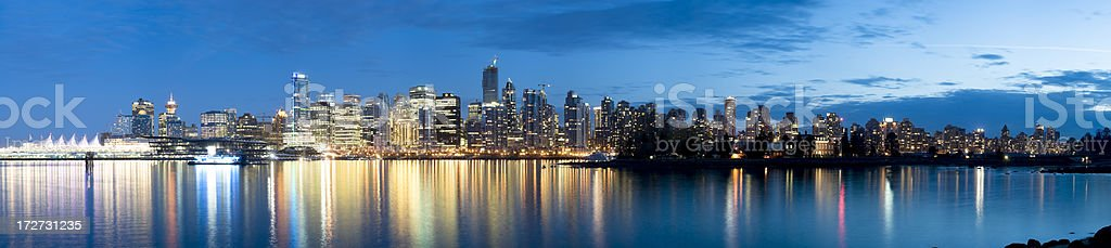 A panoramic view of the Vancouver skyline with water and sky stock photo