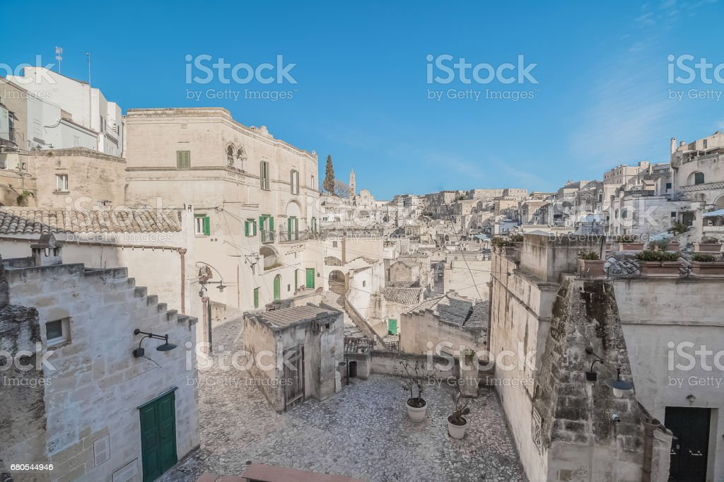 panoramic view of typical stones (Sassi di Matera) near gravina of Matera UNESCO European Capital of Culture 2019 on blue sky stock photo