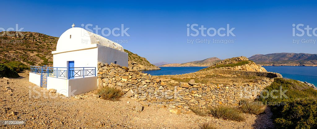 Panoramic view of white chapel at beautiful ocean coastline, Gre stock photo