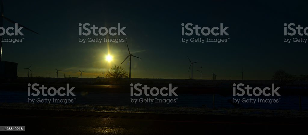 Panoramic view of wind turbines at sunset stock photo