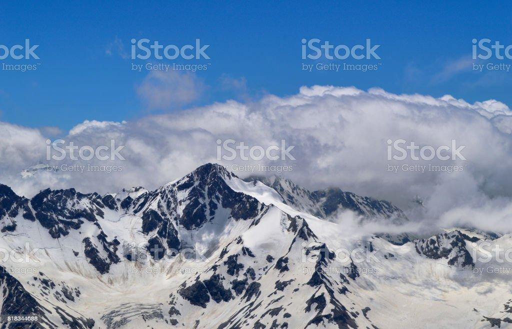 Panoramic view on Caucasus Mountain Range stock photo