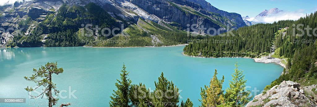 Panoramic view on Lake Oeschinensee in the Swiss Alps stock photo
