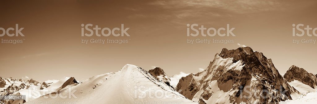 Panoramic view on off-piste slope in snow winter mountains stock photo