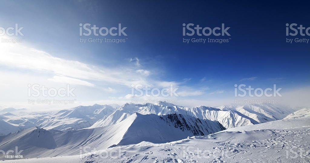 Panoramic view on snowy mountains at nice day stock photo