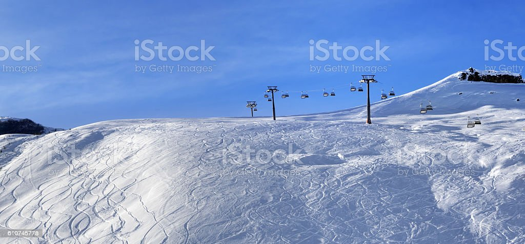 Panoramic view on sunlight off-piste slope at morning stock photo