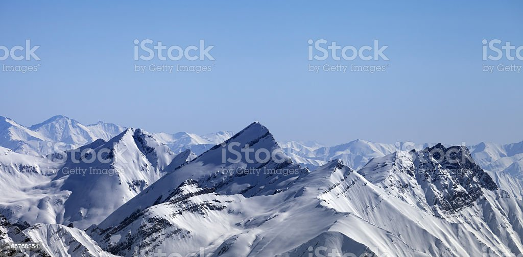 Panoramic view on winter mountains at morning stock photo