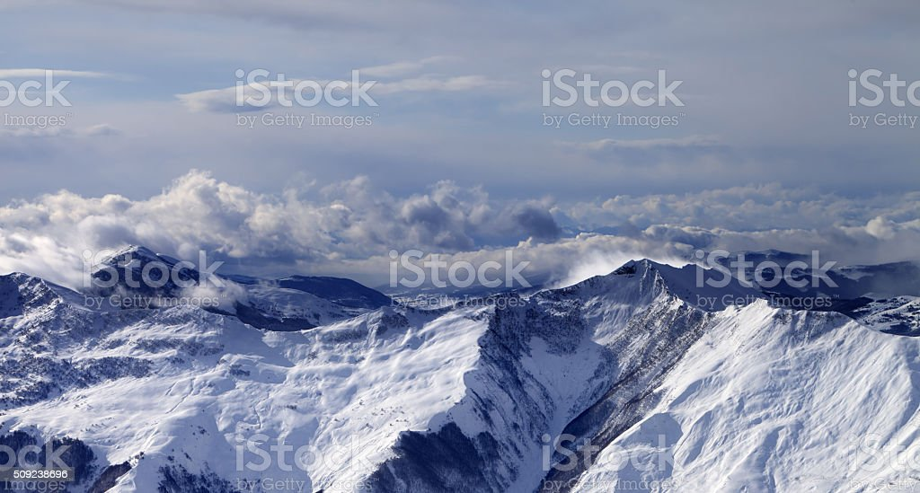 Panoramic view on winter mountains in clouds stock photo