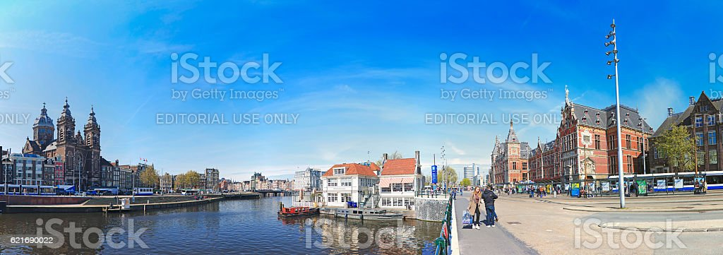 Panoramic view St Nicholas church and Amsterdam central railway station stock photo