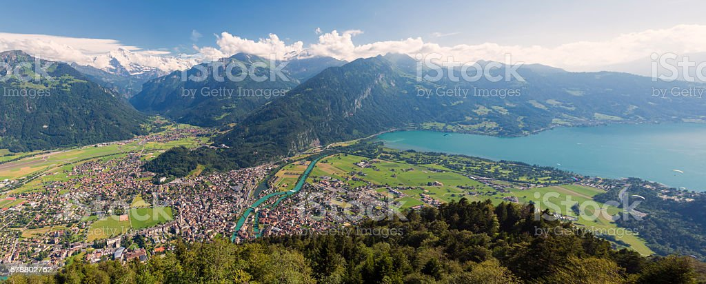 panoramic view to city Interlaken and mountain Jungfrau in Switzerland stock photo