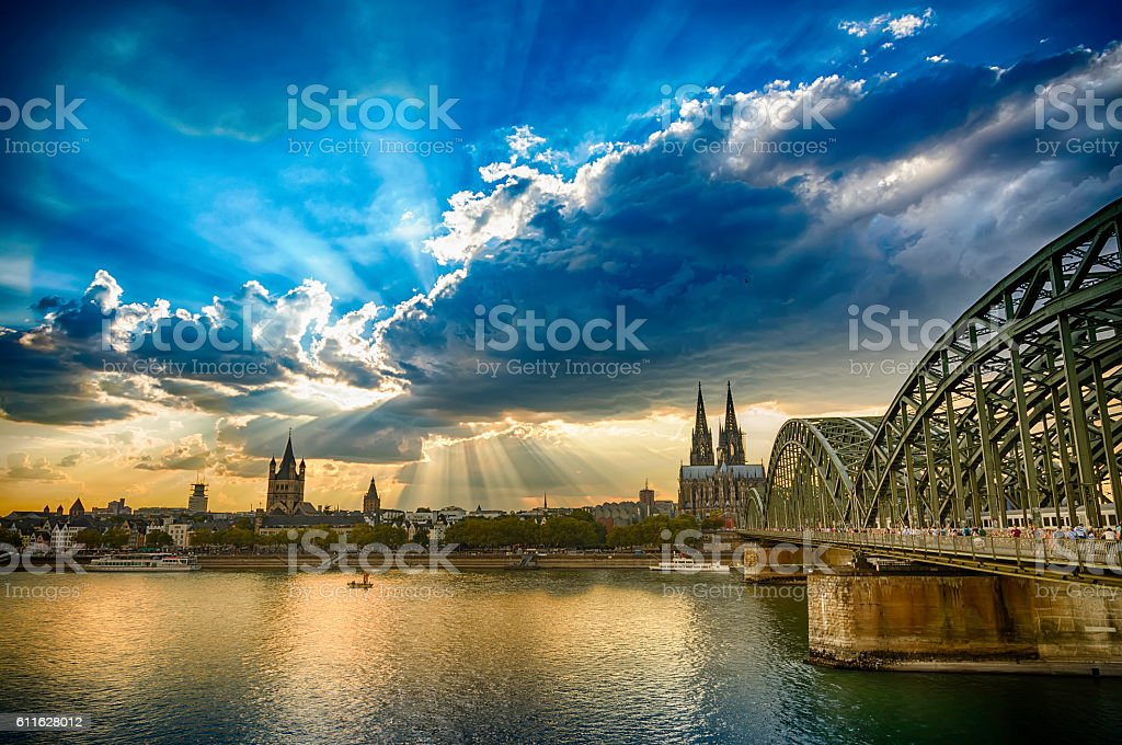Panoramic view to Cologne Cathedral and Hohenzollernbrücke at sunset (HDR) stock photo