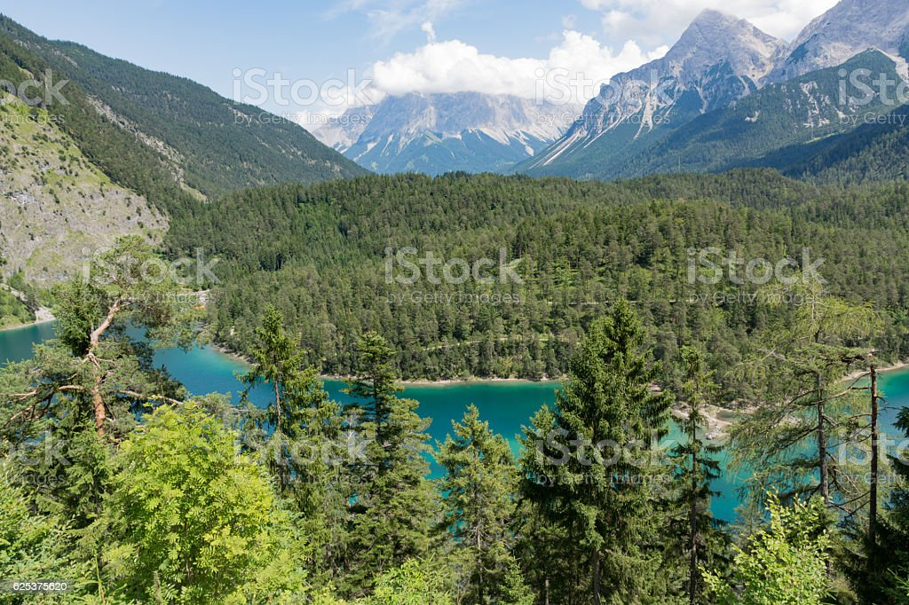 Panoramic view to the Zugspitze Mountain and Lake Blindsee, Austria stock photo