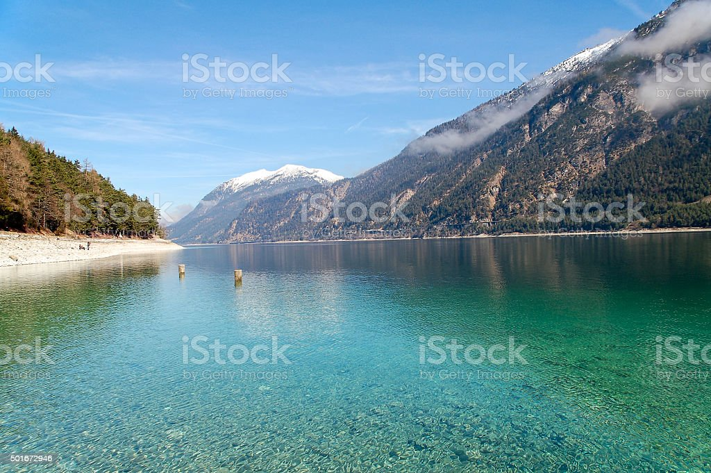 Panoramic views of Lake Achen with clouds and mountains stock photo