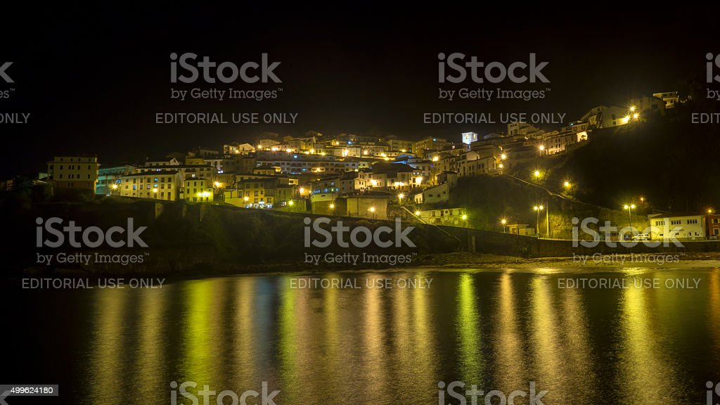 Panoramica Night view of Lastres stock photo