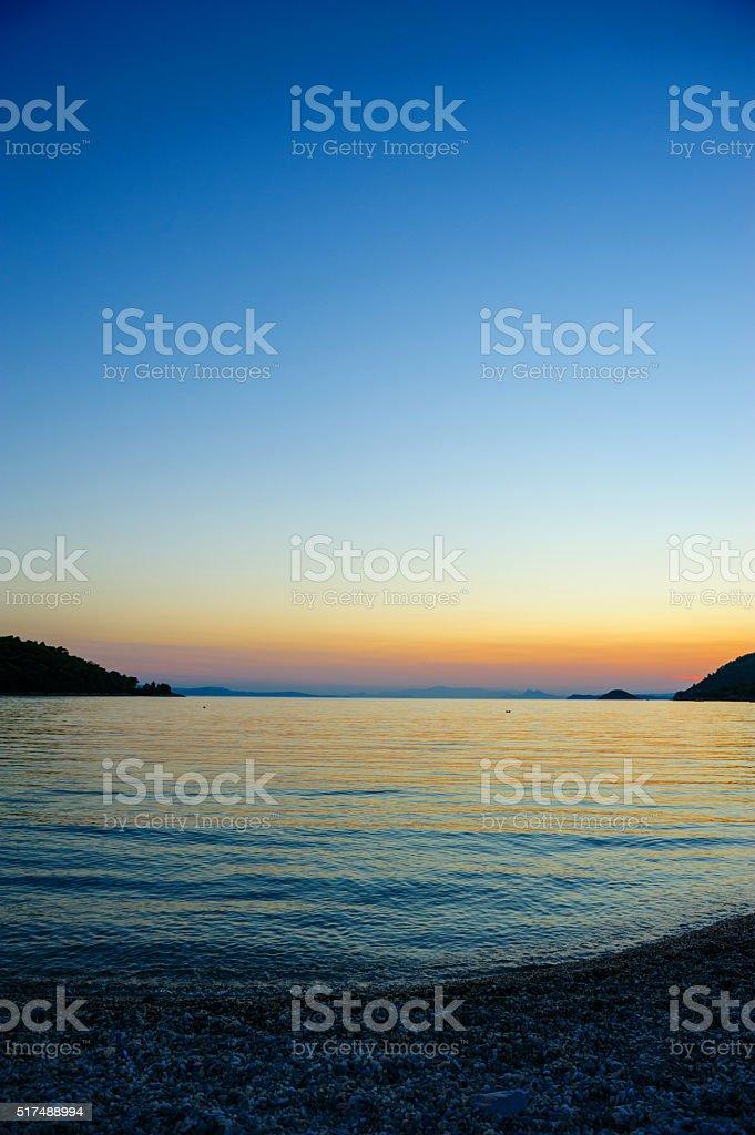 Panormos bay at sunset stock photo