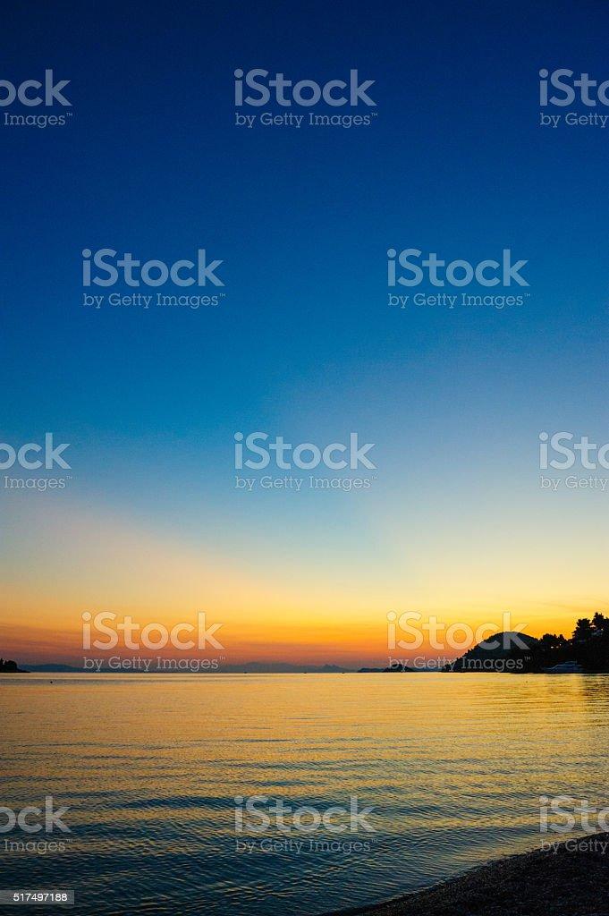 Panormos bay sunset stock photo