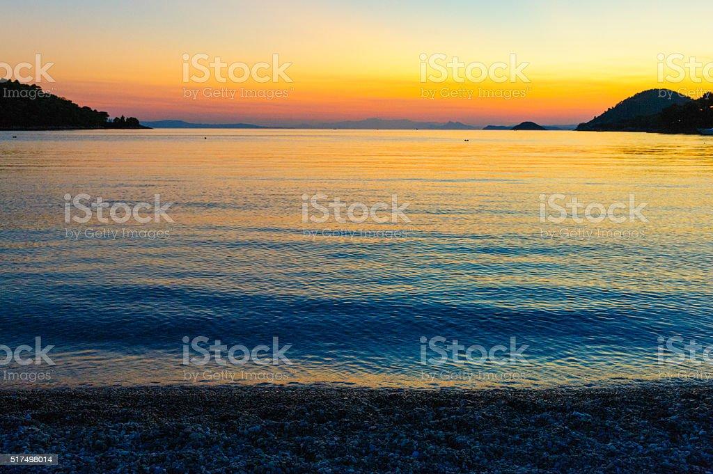 Panormos bay sunset Skopelos stock photo