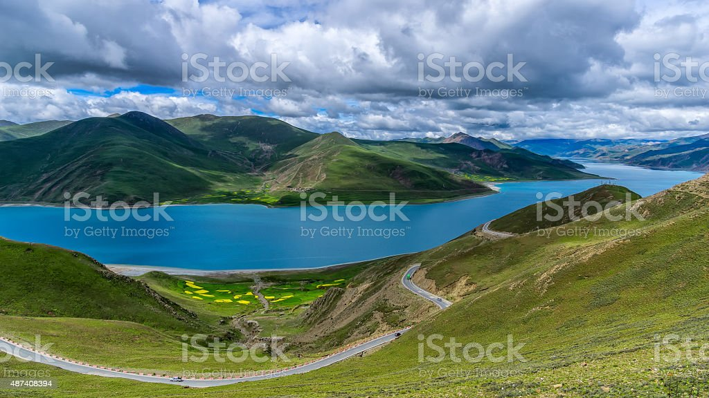 Panoromic View of Yamzho Yumco Lake in a Cloudy Day stock photo