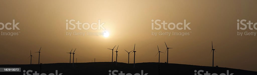Panoromic wind farm sunset stock photo