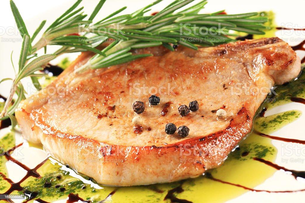 Pan-roasted pork chop royalty-free stock photo
