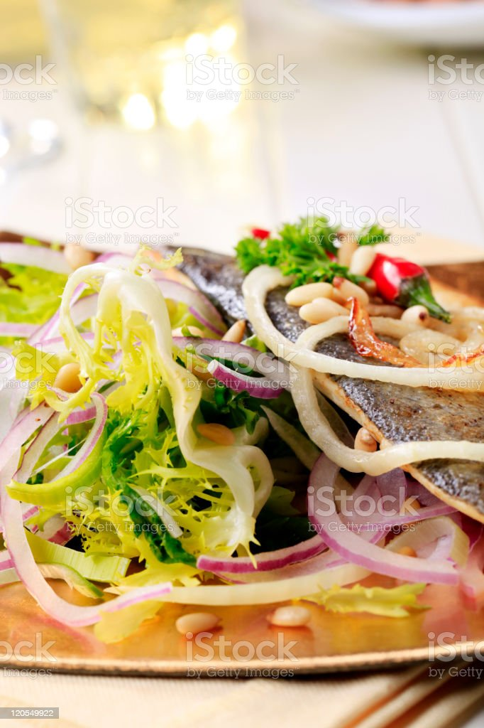 Pan-roasted trout and green salad royalty-free stock photo