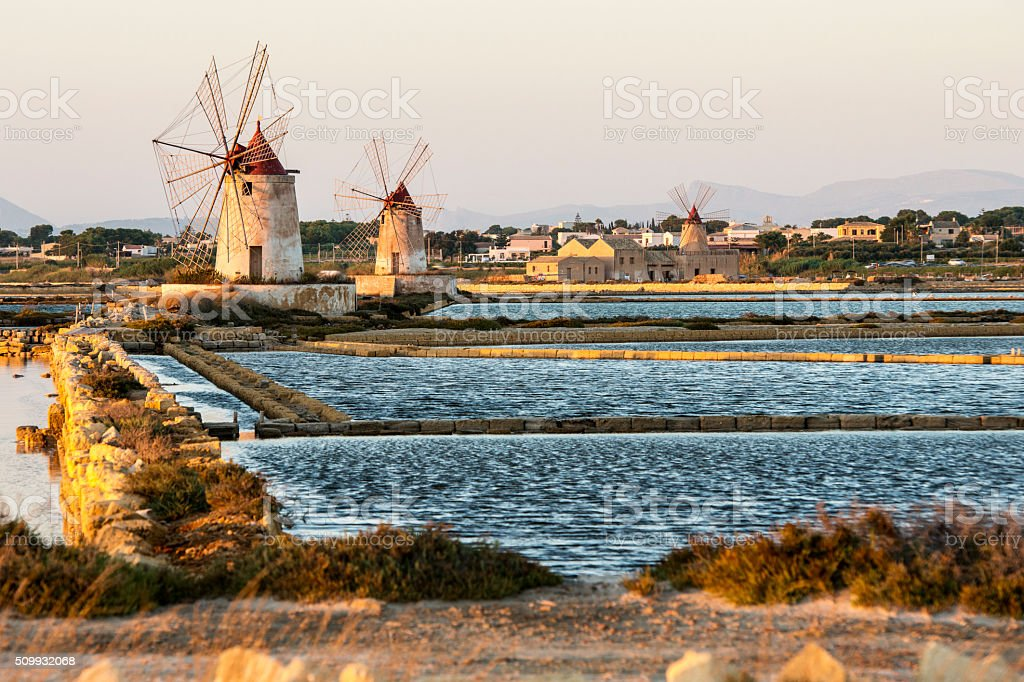Pans of Trapani with windmills, in Sicily stock photo